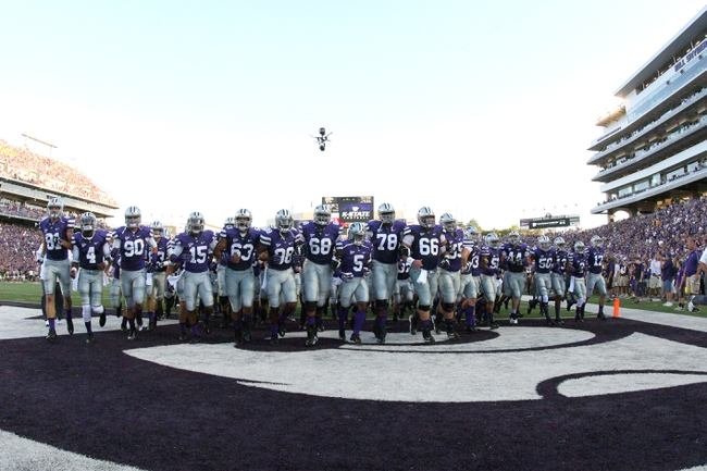 Aug 30, 2013; Manhattan, KS, USA; Kansas State Wildcats football players run off the field after pre-game warm-ups before the start of a game against the North Dakota State Bison at Bill Snyder Family Stadium. Mandatory Credit: Scott Sewell-USA TODAY Sports