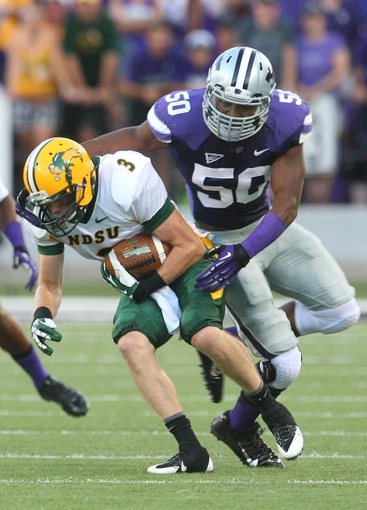 Aug 30, 2013; Manhattan, KS, USA; North Dakota State Bison wide receiver Trevor Gebhart (3) is tackled by Kansas State Wildcats linebacker Tre Walker (50) during first-half action at Bill Snyder Family Stadium.Mandatory Credit: Scott Sewell-USA TODAY Sports