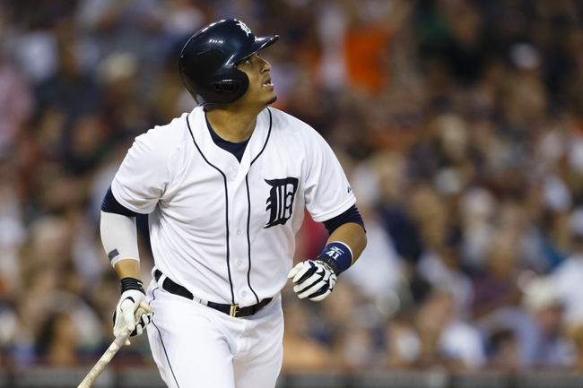 Aug 30, 2013; Detroit, MI, USA; Detroit Tigers designated hitter Victor Martinez (41) hits a two RBI double third inning against the Cleveland Indians at Comerica Park. Mandatory Credit: Rick Osentoski-USA TODAY Sports