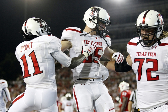 Aug 30, 2013; Dallas, TX, USA; Texas Tech Red Raiders wide receiver Jordan Davis (85) and wide receiver Jakeem Grant (11) celebrate a touchdown in the second quarter of the game against the Southern Methodist Mustangsat Gerald J. Ford Stadium. Mandatory Credit: Tim Heitman-USA TODAY Sports