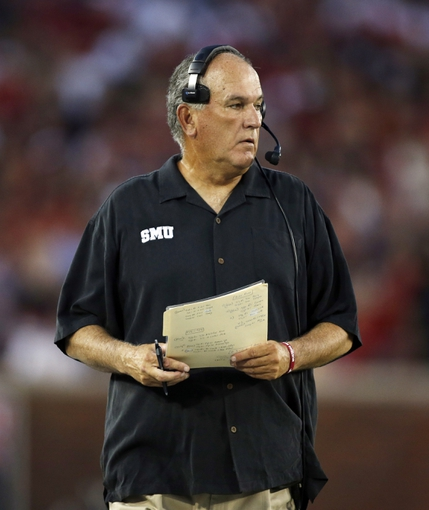 Aug 30, 2013; Dallas, TX, USA; Southern Methodist Mustangs head coach June Jones on the sidelines during the game against the Texas Tech Red Raiders  at Gerald J. Ford Stadium. Mandatory Credit: Tim Heitman-USA TODAY Sports