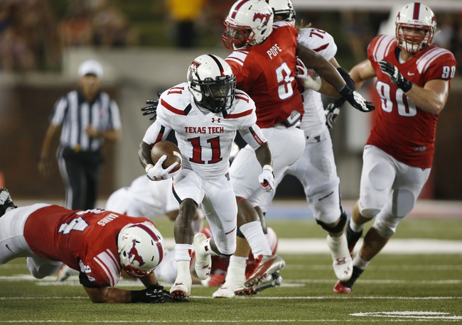 Aug 30, 2013; Dallas, TX, USA; Texas Tech Red Raiders wide receiver Jakeem Grant (11) runs the ball in the second quarter of the game against the Southern Methodist Mustangs at Gerald J. Ford Stadium. Mandatory Credit: Tim Heitman-USA TODAY Sports
