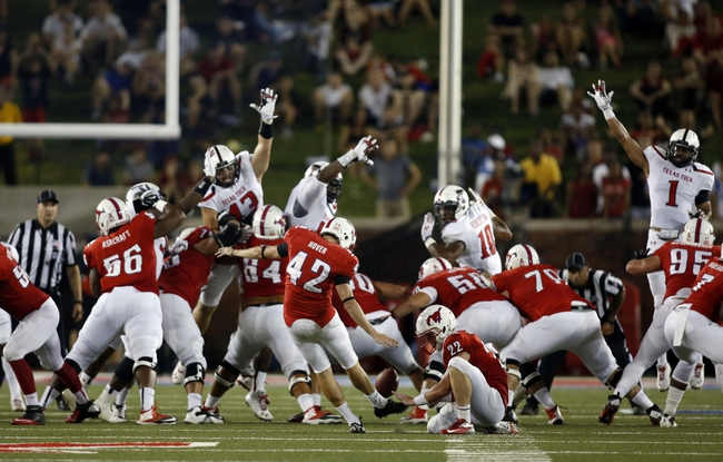 Aug 30, 2013; Dallas, TX, USA; Southern Methodist Mustangs kicker Chase Hover (42) kicks a 51 yard field goal at the end of the second quarter of the game against the Texas Tech Red Raiders at Gerald J. Ford Stadium. Mandatory Credit: Tim Heitman-USA TODAY Sports
