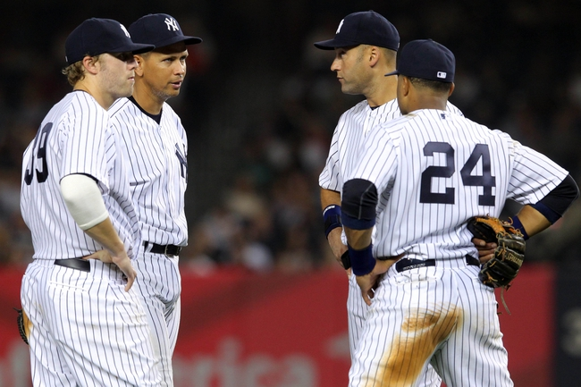 Aug 30, 2013; Bronx, NY, USA; New York Yankees first baseman Mark Reynolds (39) and third baseman Alex Rodriguez (13) and shortstop Derek Jeter (2) and second baseman Robinson Cano (24) talk during a pitching change during the seventh inning of a game against the Baltimore Orioles at Yankee Stadium. Mandatory Credit: Brad Penner-USA TODAY Sports