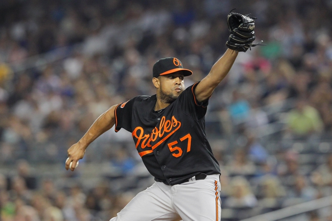 Aug 30, 2013; Bronx, NY, USA; Baltimore Orioles relief pitcher Francisco Rodriguez (57) pitches against the New York Yankees during the seventh inning of a game at Yankee Stadium. Mandatory Credit: Brad Penner-USA TODAY Sports