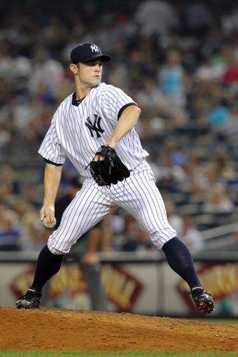Aug 30, 2013; Bronx, NY, USA; New York Yankees relief pitcher David Robertson (30) pitches against the Baltimore Orioles during the eighth inning of a game at Yankee Stadium. Mandatory Credit: Brad Penner-USA TODAY Sports