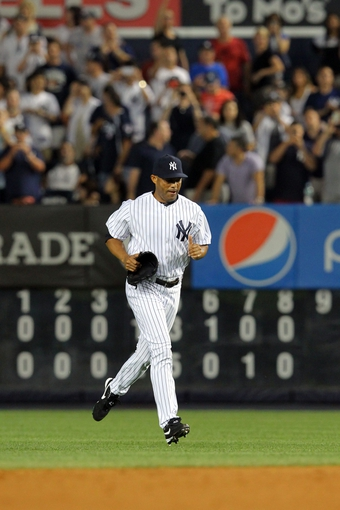 Aug 30, 2013; Bronx, NY, USA; New York Yankees relief pitcher Mariano Rivera (42) runs in from the bullpen before the ninth inning of a game against the Baltimore Orioles at Yankee Stadium. Mandatory Credit: Brad Penner-USA TODAY Sports