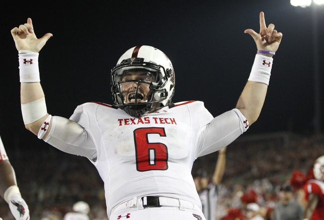 Aug 30, 2013; Dallas, TX, USA; Texas Tech Red Raiders quarterback Baker Mayfield (6) celebrates scoring a touchdown in the fourth quarter of the game against the Southern Methodist Mustangs at Gerald J. Ford Stadium. Texas Tech won 41-23. Mandatory Credit: Tim Heitman-USA TODAY Sports