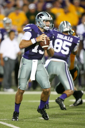 Aug 30, 2013; Manhattan, KS, USA; Kansas State Wildcats quarterback Jake Waters (15) drops back to pass during a 24-21 loss to the North Dakota State Bison at Bill Snyder Family Stadium. Mandatory Credit: Scott Sewell-USA TODAY Sports