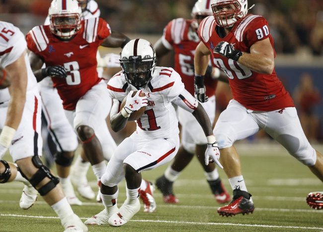 Aug 30, 2013; Dallas, TX, USA; Texas Tech Red Raiders wide receiver Jakeem Grant (11) runs the ball during the game against the Southern Methodist Mustangs at Gerald J. Ford Stadium. Texas Tech won 41-23. Mandatory Credit: Tim Heitman-USA TODAY Sports