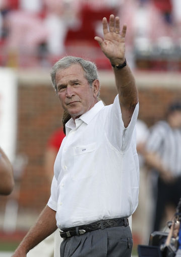 Aug 30, 2013; Dallas, TX, USA; Former president George W. Bush waves to the crowd before the game between the Southern Methodist Mustangs and the Texas Tech Red Raiders at Gerald J. Ford Stadium. Texas Tech won 41-23. Mandatory Credit: Tim Heitman-USA TODAY Sports