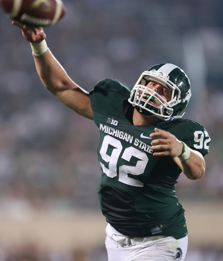 Aug 30, 2013; East Lansing, MI, USA; Michigan State Spartans defensive end Joel Heath (92) tips pass of Western Michigan Broncos quarterback Zach Terrell (11)(not pictured)during 2nd  half of a game at Spartan Stadium. MSU won 26-13.   Mandatory Credit: Mike Carter-USA TODAY Sports
