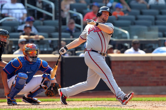 Aug 21, 2013; New York, NY, USA; Atlanta Braves catcher Brian McCann (16) bats against the New York Mets at Citi Field. Mandatory Credit: Brad Penner-USA TODAY Sports