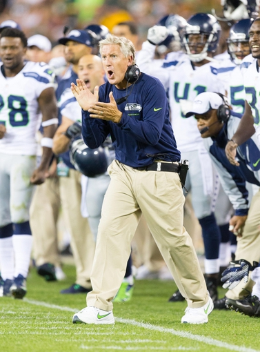 Aug 23, 2013; Green Bay, WI, USA; Seattle Seahawks head coach Pete Carroll during the game against the Green Bay Packers at Lambeau Field.  Seattle won 17-10.  Mandatory Credit: Jeff Hanisch-USA TODAY Sports