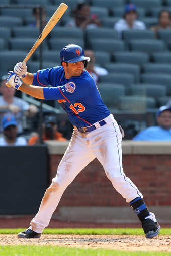 Aug 21, 2013; New York, NY, USA; New York Mets first baseman Josh Satin (13) bats against the Atlanta Braves at Citi Field. Mandatory Credit: Brad Penner-USA TODAY Sports