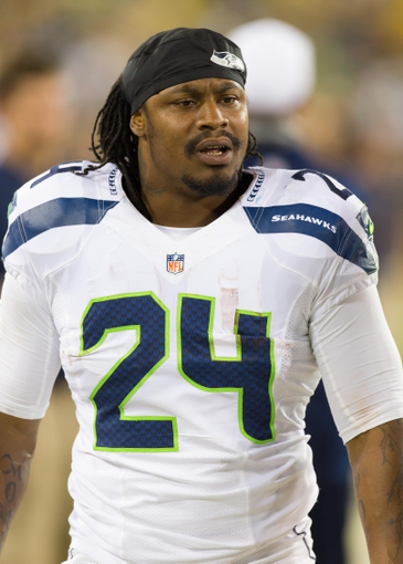 Aug 23, 2013; Green Bay, WI, USA; Seattle Seahawks running back Marshawn Lynch (24) during the game against the Green Bay Packers at Lambeau Field.  Seattle won 17-10.  Mandatory Credit: Jeff Hanisch-USA TODAY Sports