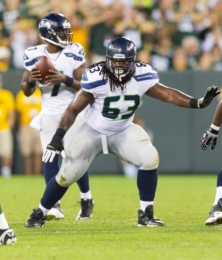 Aug 23, 2013; Green Bay, WI, USA; Seattle Seahawks guard Rishaw Johnson (63) during the game against the Green Bay Packers at Lambeau Field.  Seattle won 17-10.  Mandatory Credit: Jeff Hanisch-USA TODAY Sports