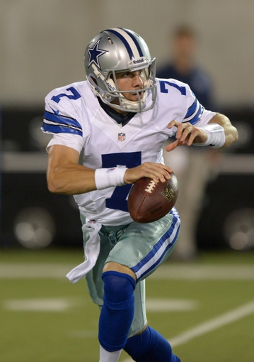 Aug 4, 2013; Canton, OH, USA; Dallas Cowboys quarterback Alex Tanney (7) scrambles in the 2013 Hall of Fame Game against the Miami Dolphins at Fawcett Stadium. The Cowboys defeated the Dolphins 24-20. Mandatory Credit: Kirby Lee-USA TODAY Sports