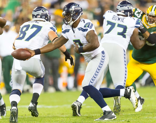 Aug 23, 2013; Green Bay, WI, USA; Seattle Seahawks quarterback Tarvaris Jackson (7) during the game against the Green Bay Packers at Lambeau Field.  Seattle won 17-10.  Mandatory Credit: Jeff Hanisch-USA TODAY Sports