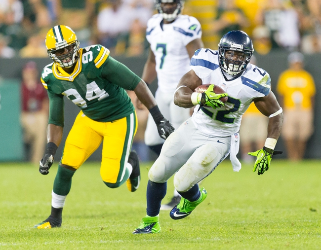 Aug 23, 2013; Green Bay, WI, USA; Seattle Seahawks running back Robert Turbin (22) during the game against the Green Bay Packers at Lambeau Field.  Seattle won 17-10.  Mandatory Credit: Jeff Hanisch-USA TODAY Sports