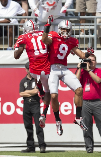 Aug 31, 2013; Columbus, OH, USA; Ohio State Buckeyes wide receivers Devin Smith (9) and Philly Brown (10) celebrate Smith's touchdown against the Buffalo Bulls at Ohio Stadium. Mandatory Credit: Greg Bartram-USA TODAY Sports