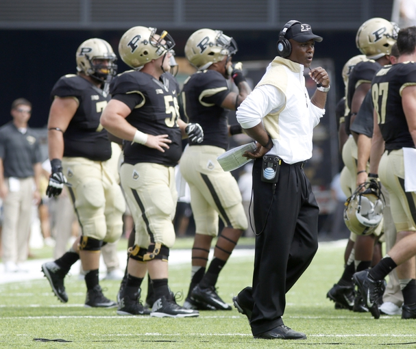 Aug 31, 2013; Cincinnati, OH, USA; Purdue Boilermakers head coach Darrell Hazell walks on the field during a time out during the first quarter against the Cincinnati Bearcats at Nippert Stadium. Mandatory Credit: David Kohl-USA TODAY Sports