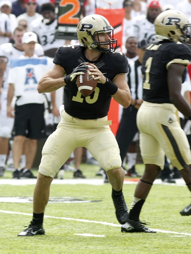 Aug 31, 2013; Cincinnati, OH, USA; Purdue Boilermakers quarterback Rob Henry (15) looks to throw against the Cincinnati Bearcats during the first quarter at Nippert Stadium. Mandatory Credit: David Kohl-USA TODAY Sports