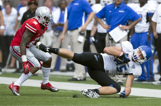 Aug 31, 2013; Columbus, OH, USA; Buffalo Bulls tight end Mason Schreck (85) makes a diving catch under coverage from Ohio State Buckeyes safety Christian Bryant (2) at Ohio Stadium. Mandatory Credit: Greg Bartram-USA TODAY Sports