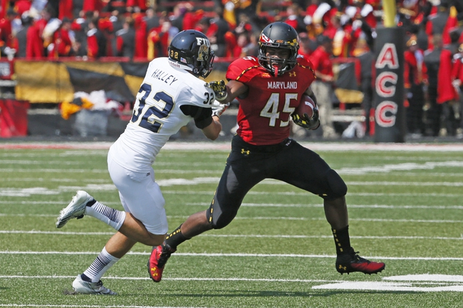 Aug 31, 2013; College Park, MD, USA; Maryland Terrapins running back Brandon Ross (45) runs for a gain against Florida International Panthers safety Justin Haley (32) at Byrd Stadium. Mandatory Credit: Mitch Stringer-USA TODAY Sports