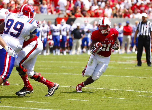 August 31, 2013; Raleigh, NC, USA;  North Carolina State running back Matt Dayes (21) carries the ball for a touchdown during the 2nd quarter against Louisiana Tech at Carter Finley Stadium. Mandatory Credit: James Guillory-USA TODAY Sports