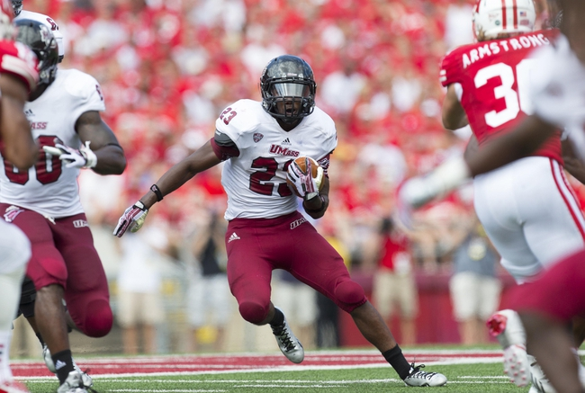 Aug 31, 2013; Madison, WI, USA; Massachusetts Minutemen running back Stacey Bedell (23) rushes with the football during the third quarter against the Wisconsin Badgers at Camp Randall Stadium.  Wisconsin won 45-0.  Mandatory Credit: Jeff Hanisch-USA TODAY Sports
