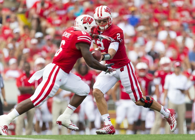 Aug 31, 2013; Madison, WI, USA; Wisconsin Badgers quarterback Joel Stave (2) hands the football to running back Corey Clement (6) during the third quarter against the Massachusetts Minutemen at Camp Randall Stadium. Mandatory Credit: Jeff Hanisch-USA TODAY Sports