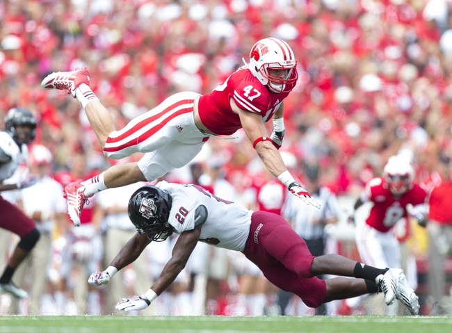 Aug 31, 2013; Madison, WI, USA; Wisconsin Badgers linebacker Vince Biegel (47) is blocked by Massachusetts Minutemen running back Lorenzo Woodley (20) during the fourth quarter at Camp Randall Stadium.  Wisconsin won 45-0.  Mandatory Credit: Jeff Hanisch-USA TODAY Sports
