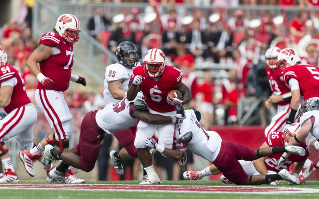 Aug 31, 2013; Madison, WI, USA; Wisconsin Badgers running back Corey Clement (6) rushes with the football during the fourth quarter against the Massachusetts Minutemen at Camp Randall Stadium.  Wisconsin won 45-0.  Mandatory Credit: Jeff Hanisch-USA TODAY Sports