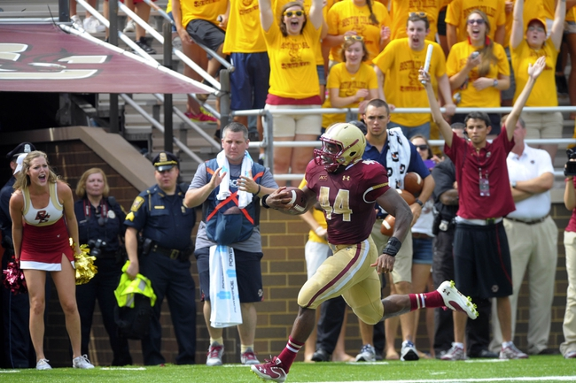 Aug 31, 2013; Boston, MA, USA; Boston College Eagles running back Andre Williams (44) scores a touchdown during the second half against the Villanova Wildcats at Alumni Stadium. Mandatory Credit: Bob DeChiara-USA TODAY Sports