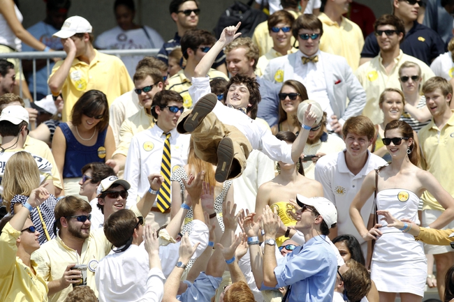 Aug 31, 2013; Atlanta, GA, USA; Georgia Tech Yellow Jackets student and fan is tossed in the air after a touchdown against the Elon Phoenix in the second quarter at Bobby Dodd Stadium. Mandatory Credit: Brett Davis-USA TODAY Sports