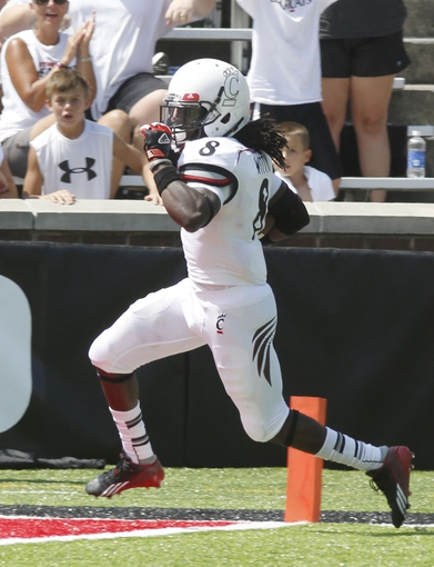 Aug 31, 2013; Cincinnati, OH; Cincinnati Bearcats safety Adrian Witty (8) runs in for a 41 yard interception return during the third quarter against the Purdue Boilermakers at Nippert Stadium. Cincinnati won 42-7. Mandatory Credit: David Kohl-USA TODAY Sports