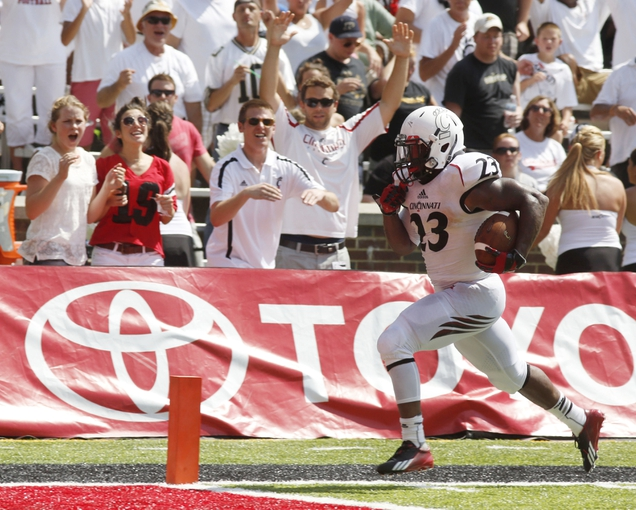 Aug 31, 2013; Cincinnati, OH, USA; Cincinnati Bearcats running back Hosey Williams (23) runs a 30 yard touchdown during the fourth quarter against the Purdue Boilermakers at Nippert Stadium. Cincinnati won 42-7. Mandatory Credit: David Kohl-USA TODAY Sports