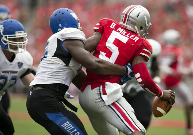 Aug 31, 2013; Columbus, OH, USA; Buffalo Bulls linebacker Khalil Mack (46) tackles Ohio State Buckeyes quarterback Braxton Miller (5) at Ohio Stadium. Ohio State won the game 40-20. Mandatory Credit: Greg Bartram-USA TODAY Sports