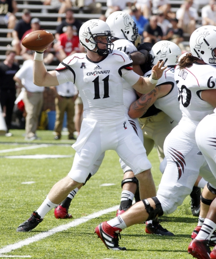 Aug 31, 2013; Cincinnati, OH, USA; Cincinnati Bearcats quarterback Brendon Kay (11) throws against the Purdue Boilermakers during the second half at Nippert Stadium. The  Cincinnati won 42-7. Mandatory Credit: David Kohl-USA TODAY Sports