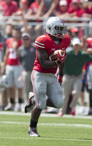 Aug 31, 2013; Columbus, OH, USA; Ohio State Buckeyes running back Jordan Hall (7) runs for a touchdown against the Buffalo Bulls at Ohio Stadium. Mandatory Credit: Greg Bartram-USA TODAY Sports