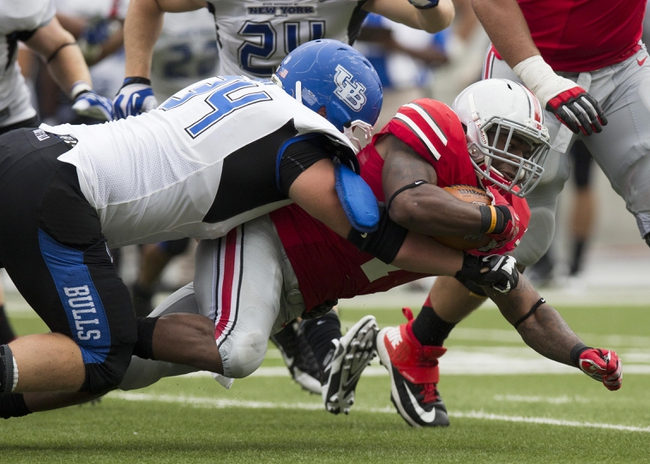 Aug 31, 2013; Columbus, OH, USA; Ohio State Buckeyes running back Jordan Hall (7) dives for extra yardage as Buffalo Bulls defensive lineman Colby Way (34) tackles him at Ohio Stadium. Ohio State won the game 40-20. Mandatory Credit: Greg Bartram-USA TODAY Sports