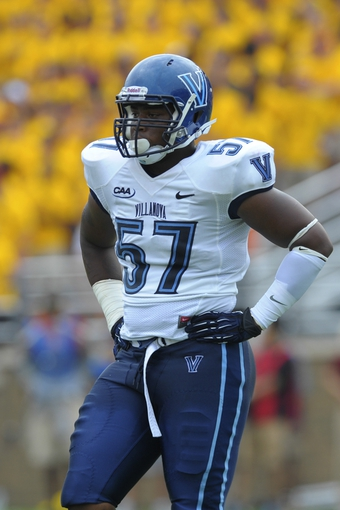 Aug 31, 2013; Boston, MA, USA; Villanova Wildcats defensive lineman Noble Ajakaiye (57) during a timeout in the second against the Boston College Eagles at Alumni Stadium. Mandatory Credit: Bob DeChiara-USA TODAY Sports
