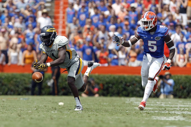 Aug 31, 2013; Gainesville, FL, USA; Toledo Rockets wide receiver Bernard Reedy (1) misses the ball as Florida Gators defensive back Marcus Roberson (5) defends during the second half at Ben Hill Griffin Stadium. Florida Gators defeated the Toledo Rockets 24-6. Mandatory Credit: Kim Klement-USA TODAY Sports