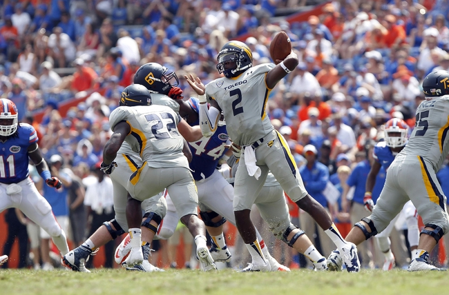 Aug 31, 2013; Gainesville, FL, USA; Toledo Rockets quarterback Terrance Owens (2) throws the ball against the Florida Gators during the second half at Ben Hill Griffin Stadium. Florida Gators defeated the Toledo Rockets 24-6. Mandatory Credit: Kim Klement-USA TODAY Sports