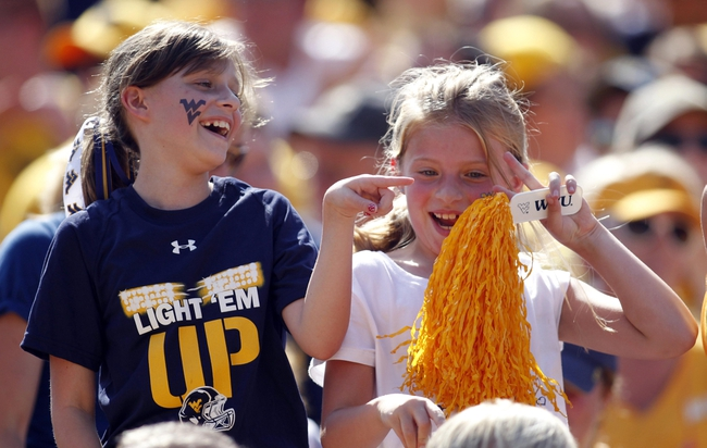 Aug 31, 2013; Morgantown, WV, USA; West Virginia Mountaineers fans dance in the stands against the William & Mary Tribe during the fourth quarter at Milan Puskar Stadium. The West Virginia Mountaineers won 24-17. Mandatory Credit: Charles LeClaire-USA TODAY Sports