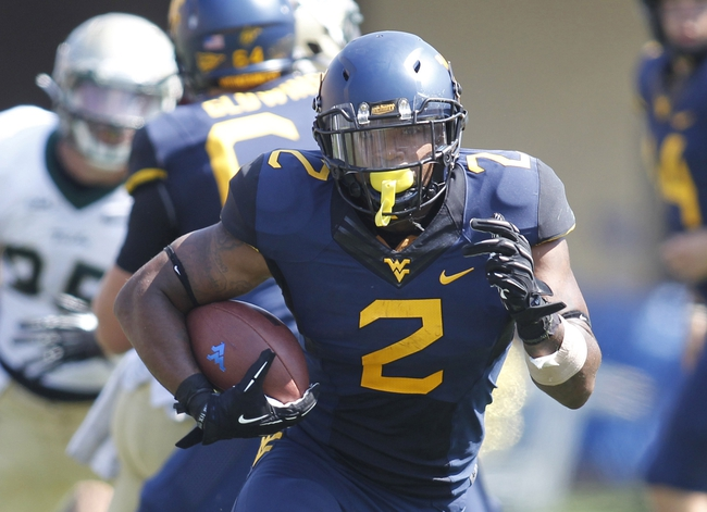 Aug 31, 2013; Morgantown, WV, USA; West Virginia Mountaineers running back Dreamius Smith (2) rushes the football against the William & Mary Tribe during the fourth quarter at Milan Puskar Stadium. The West Virginia Mountaineers won 24-17. Mandatory Credit: Charles LeClaire-USA TODAY Sports