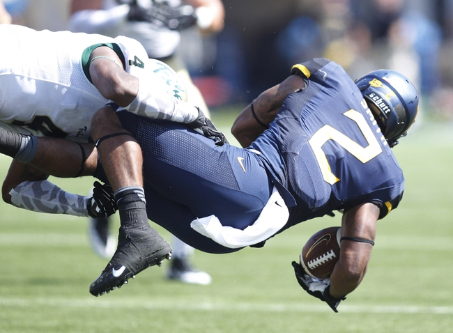 Aug 31, 2013; Morgantown, WV, USA; William & Mary Tribe safety Jerome Couplin (4) makes a tackle on West Virginia Mountaineers running back Dreamius Smith (2) during the fourth quarter at Milan Puskar Stadium. The West Virginia Mountaineers won 24-17. Mandatory Credit: Charles LeClaire-USA TODAY Sports