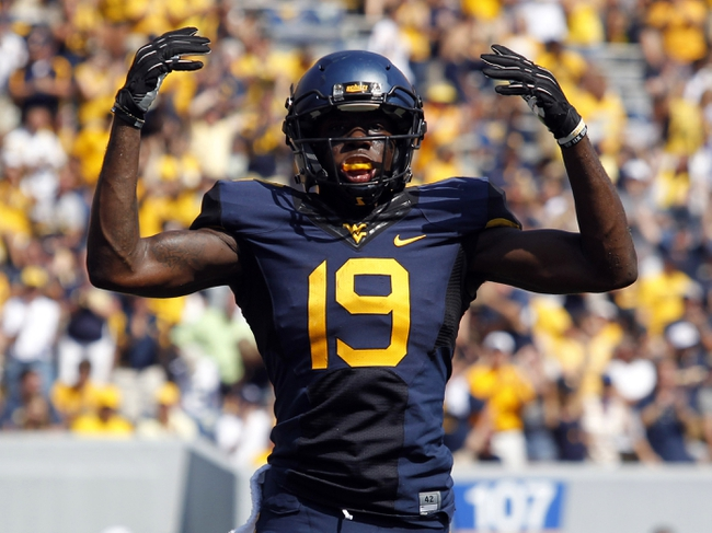 Aug 31, 2013; Morgantown, WV, USA; West Virginia Mountaineers wide receiver K.J. Myers (19) celebrates a WVU touchdown against the William & Mary Tribe during the fourth quarter at Milan Puskar Stadium. The West Virginia Mountaineers won 24-17. Mandatory Credit: Charles LeClaire-USA TODAY Sports