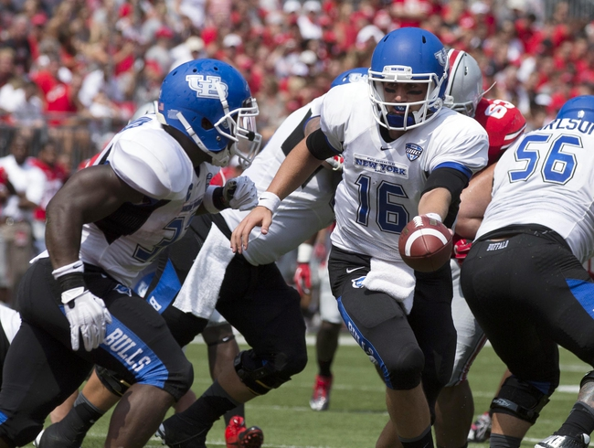 Aug 31, 2013; Columbus, OH, USA; Buffalo Bulls quarterback Joe Licata (16) hands the ball off to running back Branden Oliver (32) at Ohio Stadium. Ohio State won the game 40-20. Mandatory Credit: Greg Bartram-USA TODAY Sports